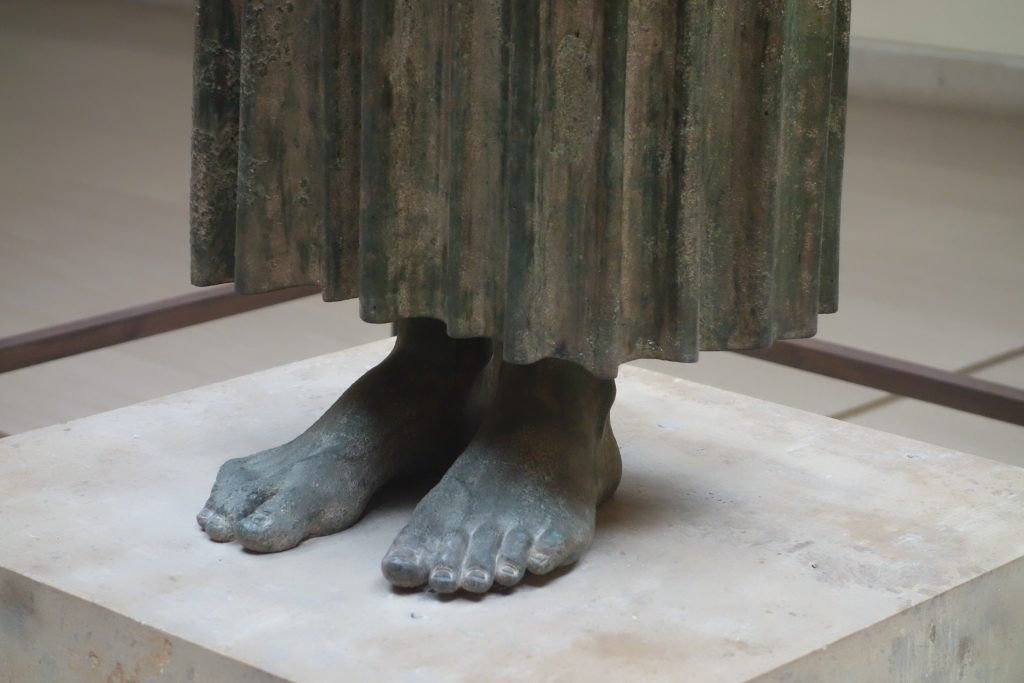 The feet of the statue
